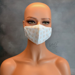 Mondkapje of medisch gezichtsmasker wit met blauwe stip en grijze bloem