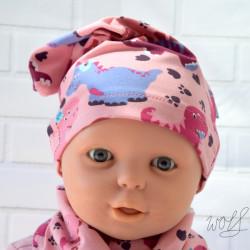 Handgemaakte beanie voor baby's met roze dino's